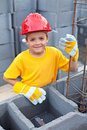 Boy at construction site Royalty Free Stock Photo