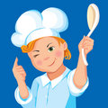 Boy cook with a spoon on a blue background Stock Image