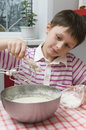 Boy cooking Stock Image