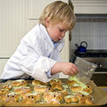 Boy cooking Stock Photography
