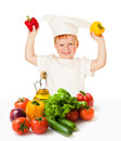 Boy in cooking hat with vegetables isolated on white Stock Images