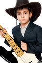 Boy in a cowboy hat and guitar Stock Photo