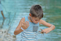 Boy with crab Royalty Free Stock Photo