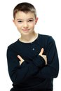 Boy with crossed arms portrait of handsome eleven years old on white background Stock Photos
