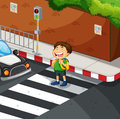 Boy crossing the road at zebra crossing Royalty Free Stock Photo