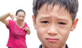 Boy crying while mother scold him young asian Stock Image