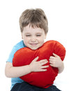 Boy cuddling heart Royalty Free Stock Photos