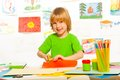 Boy cut paper and glue lesson with years old blond with scissors and smile Stock Photography