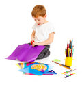 Boy cutting paper Stock Photo