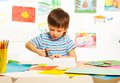 Boy cutting paper with scissors Royalty Free Stock Photo