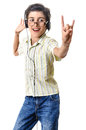 Boy dancing rock sign listening at headphones smart with showing isolated on white background Stock Photography