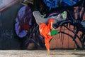 Boy dancing on the street graffity wall