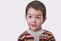 Boy with dark hair big eyes cute face on white background studio photo of little whit Stock Image