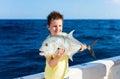 Boy deep sea fishing Royalty Free Stock Photo
