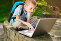 Boy delighted with laptop Stock Image