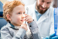Boy with dentist at the dental office Royalty Free Stock Photo