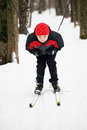 Boy descending from hill snow on skis closeup Stock Photos