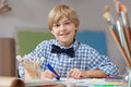 Boy developing artistic talent image of happy blonde his Royalty Free Stock Images