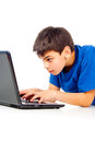 Boy diligently working at a laptop Royalty Free Stock Image