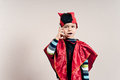Boy in disguise with the phone Royalty Free Stock Images