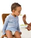 Boy disliking vegetables Royalty Free Stock Photo