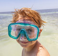 Boy with diving goggles at the beach Royalty Free Stock Photo