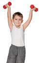 Boy do exercises with dumbbells a morning isolated on the white background Stock Photography