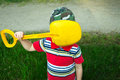 Boy does not want to be photographed covered his face with a shovel Royalty Free Stock Photo
