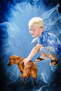 Boy and dog in another realm with abstract background Stock Image