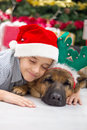 Boy and dog in christmas night two best friends celebrating Stock Images