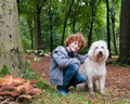 Boy and dog cute young his pet posing in an autumn forest scenery Royalty Free Stock Photo