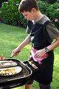 Boy doing barbecue Royalty Free Stock Photo