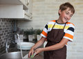 Boy doing the dishes Stock Photography