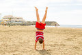Boy doing a handstand young having fun Stock Photography