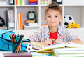 Boy doing homework smiling adolescent at the table Stock Photos