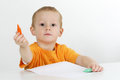 Boy drawing with crayons little giving his pencils Stock Image