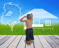 Boy drawing the house with tree on lanscape Royalty Free Stock Photo