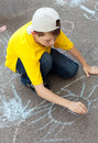 Boy draws on  asphalt Stock Photos