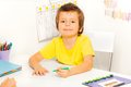 Boy draws with pen during sitting at table Royalty Free Stock Photo
