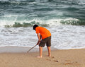 Boy draws on the sand with a stick at beach Stock Photography