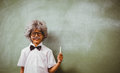 Boy dressed as senior teacher in front of blackboard Royalty Free Stock Photo