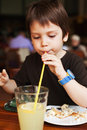 Boy drinking juice cookie was finished Royalty Free Stock Photography