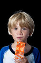 Boy drinking orange juice Stock Photo