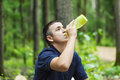 Boy drinking water on jogging trail in the woods Stock Photos