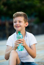 Boy drinking water Royalty Free Stock Photo