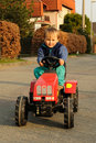 Boy driving tractor Royalty Free Stock Photos