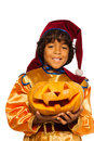 Boy in dwarf costume with carved pumpkin dark halloween holding and wearing cap smiling and looking at camera isolated on white Royalty Free Stock Image
