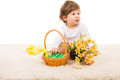 Boy with easter basket looking away and sitting on fur carpet Stock Photos