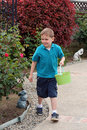 Boy on Easter Egg Hunt Stock Images