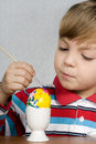 Boy and easter eggs Stock Images